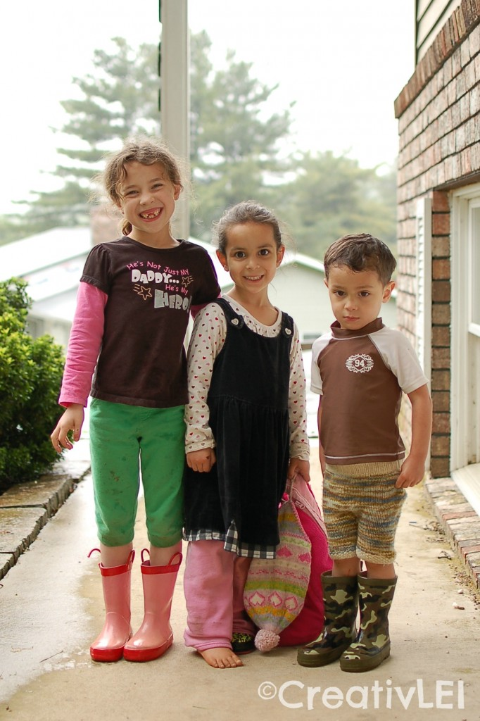 with a pair of boots and a set of play clothes a rainy day can still be an outside play day
