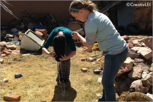 washing hair in Chupa