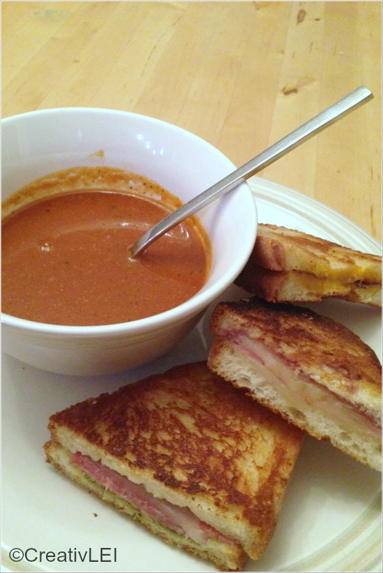 Gourmet-style grilled cheese served with creamy tomato soup