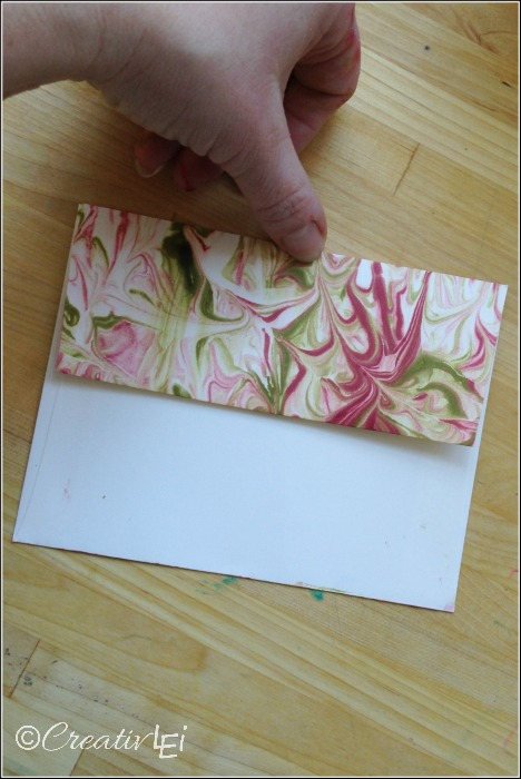 Faux marbled envelope flap using shaving cream and ink refills. CreativLEI.com